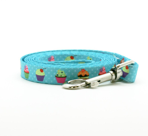 """Take your dog for a walk to the local bakery on the sweetest leash there is and everyone will notice! This sweet leash with cupcakes in a row on 5/8"""" wide turquoise webbing is 72"""" long and oh so fashion forward!"""