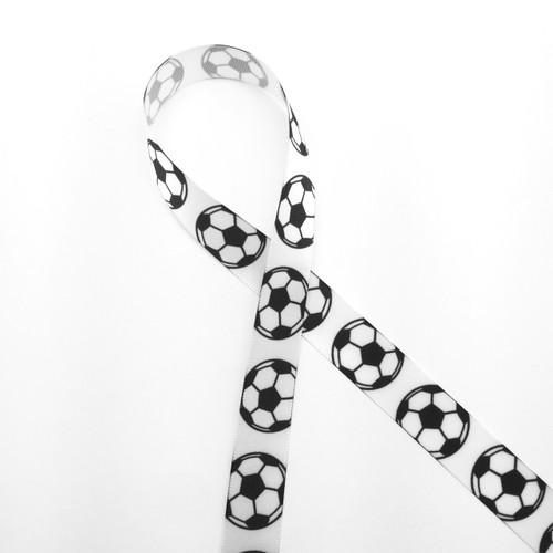 "Soccer balls lined up along our 5/8"" white single face satin ribbon. The ideal addition to a soccer themed party!"