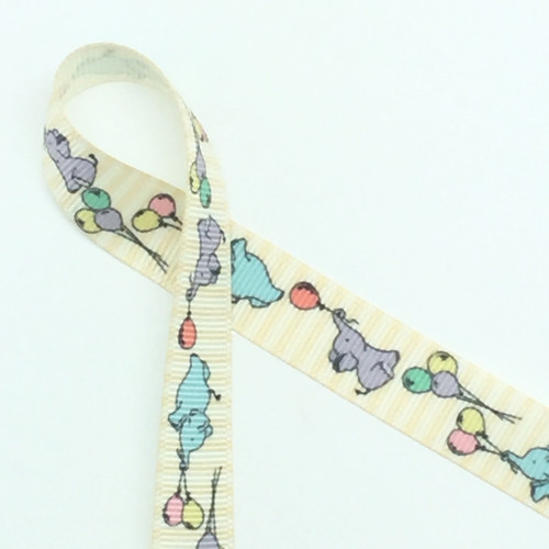 """Sweet baby elephants float along this 5/8"""" antique white grosgrain ribbon aided by balloon bouquets. Designed and printed in the USA"""