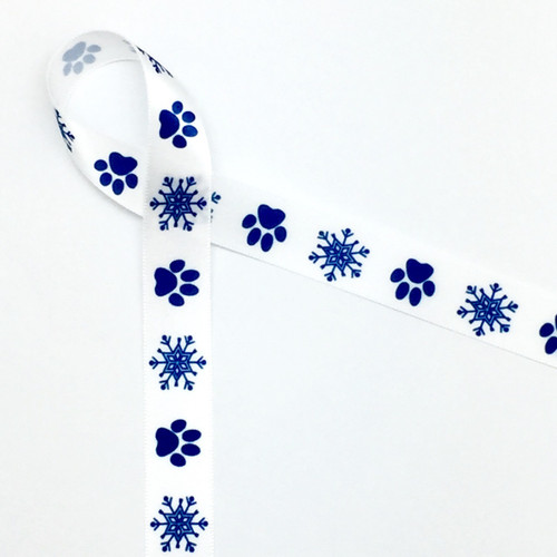 "Paw prints alternating with snowflakes in blue on a 5/8"" white satin ribbon is the ideal way to make your furry friend feel special at the Holidays!!"