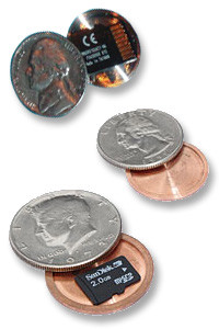 The nickel and fifty-cent piece will hold a microSD card.  The quarter will not close with a microSD card in it without modifying the card.