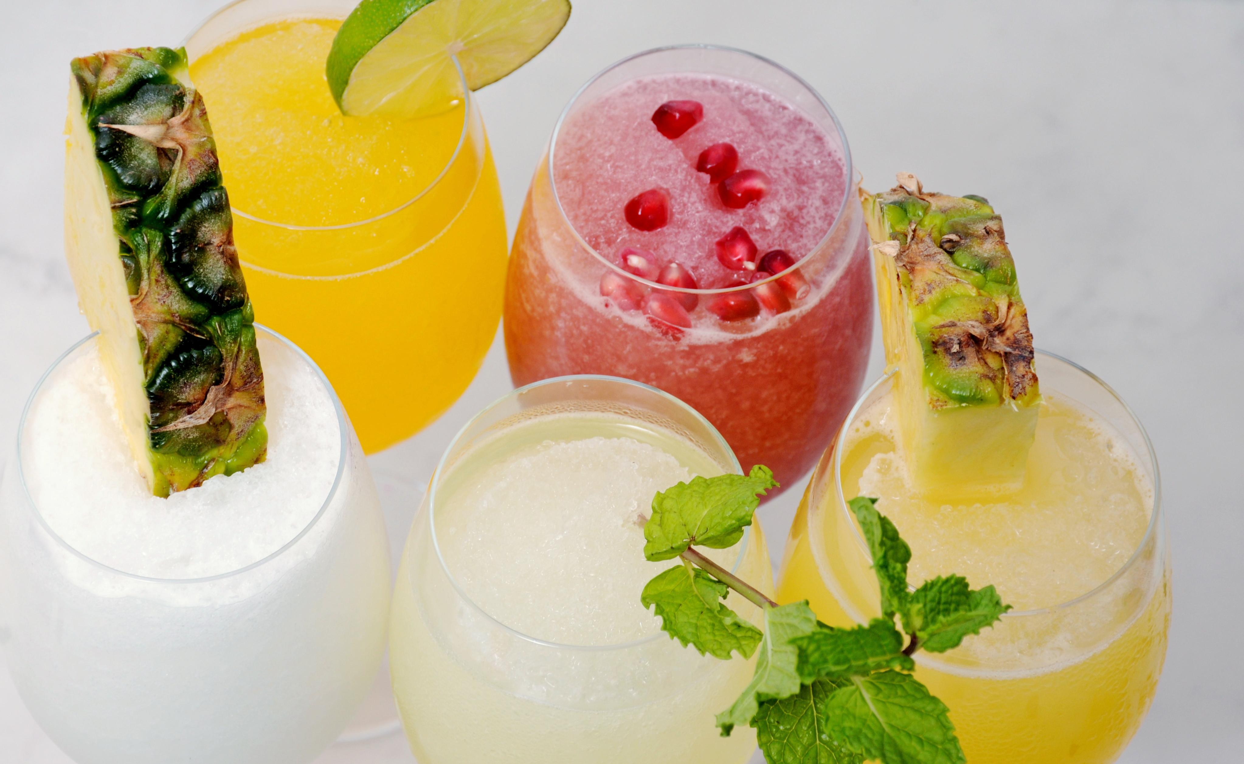 Peach Mango Bellini, Pina Colada, Mojito, Mai Tai, Watermelon Wine Slushies