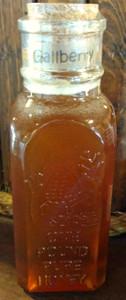 A 1lb Muth jar of Gallberry honey.