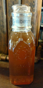 An 8oz Muth jar of Gallberry honey.