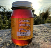 A Pint Jar Of Sorghum Honeydew Honey.