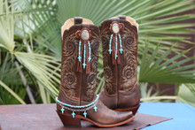 100% real leather.  Chocolate leather, Silver Plated Oval Conchos with fringe and Turquoise beads.   Pictured with Boot Candy Naturals, Turquoise Crosses with Chain 608133