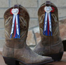 "Boot Candy Toppers,   attach to the tops of your Boots thru the Pull Straps.  This pair of Boot Candy Boot Toppers have Silver Slotted Heart Conchos with Red, White and Blue Leather Fringe.  A perfect way to show your American Spirit.   Add subtle elegance to your boots.  Fringe measures 7"",  Concho measures 1.5""   We are Made in the USA."