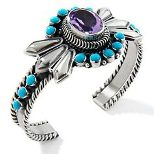 This piece was created by Navajo silversmith Emerson Delgarito. Features African Amethyst and Sleeping Beauty Turquoise. Made in Sterling silver .925