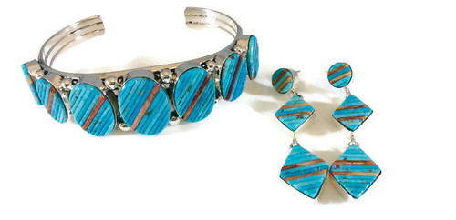 Created by Navajo artist Irvin Tsosie and inlayed by Navajo artist Patricia Smith