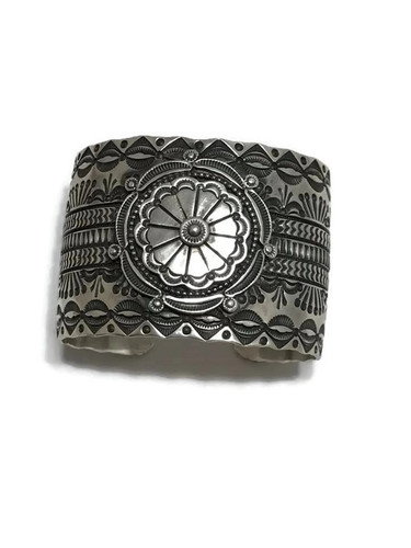 "Navajo made sterling silver cuff stamped on the inside with the makers mark ""Wallace Jr."""