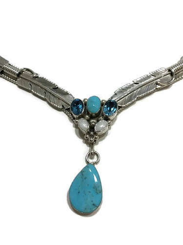 Native American made turquoise, swiss blue topaz, and opal necklace.
