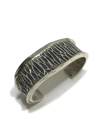 "Native American made sterling silver cuff bracelet with a stamp of ""EDG""."