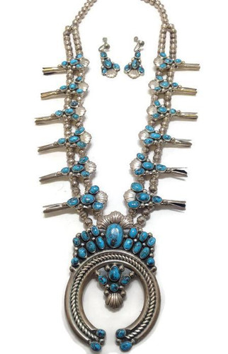 "Navajo old pawn squash blossom necklace with a makers mark of ""TKW""."