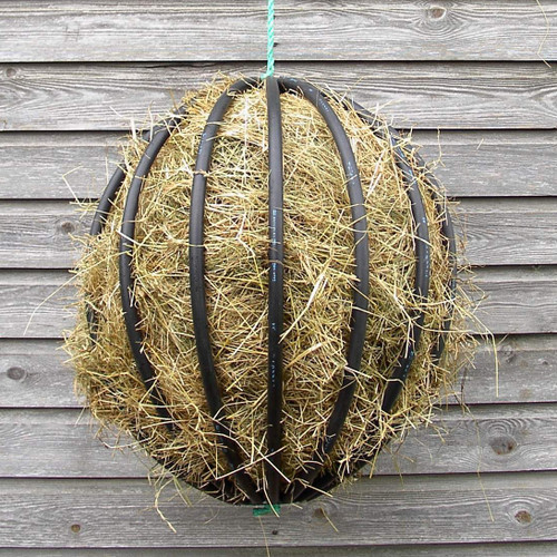 Filling a Hayball is so easy - simply push hay through the flexible bars. You dedice how full you want it.