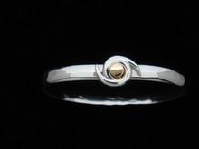 Silver & 14K Gold 6mm Hurricane Symbol Bracelet