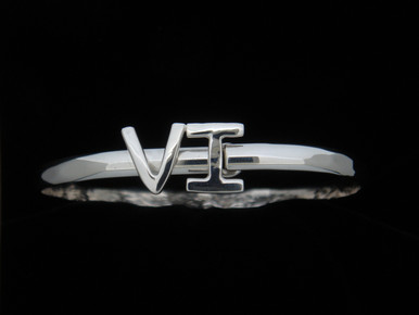 "The ""VI"" stands for Virgin Islands... It is all silver on a 5mm band.  It has a pin on the bottom of the design to keep it closed."