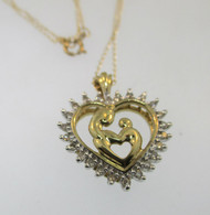 """10k Yellow Gold Heart Shaped Mother and Child Pendant with Approx. .25ct TW of Diamonds Framing Pendant. 18.5"""" Yellow Gold Chain*"""