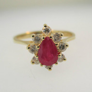 14k Yellow Gold Pear Shape Ruby Ring with Approx .25ct TW Round Brilliant Cut Diamond Accents Size 6 1/4