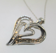 10k White Gold Heart Shaped Pendant with Approx. .25ct TW of Channel Set Diamond