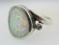 Sterling Silver Ring with Synthetic Opal Ring with Cubic Zirconia Accent. Size 8 ¾