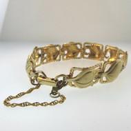 Vtg YG Tone Sterling Beau Link Bangle Bracelet w Safety Chain Curled Leaf Design