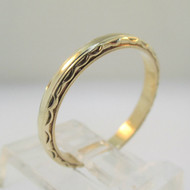 14k Yellow Gold 2.1g Band with Detailing on Ring Size 6 1/2