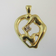 10k Yellow Gold Diamond Accented Mother and Child Pendant