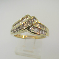 14k Yellow Gold Approx 1.0ct TW Round Brilliant and Baguette Diamond Fashion Ring Size 7