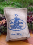 "Peaberry Jamaica Blue Mountain Coffee in 8 oz. burlap bag - note: ""Peaberry"" tag not seen on this image."