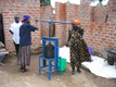 Local women use manual hand press to make shea butter in Lira, northern Uganda.  Our manual pressing like this helps preserve the natural properties and freshness of the shea butter.