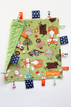 Small Woodland Animals tag blanket with green back.