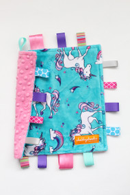 Small Unicorns tag blanket with pink minky back.