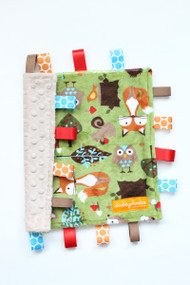 Small Woodland Animals tag blanket with tan back.