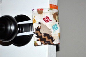 """It's all in the name! It's a door silencer. Placed over the handles of a door knob, the padded fabric blocks the latch from making noise when opening and closing the door. Great for little ones who hear you leaving after tucking them in. Also good for frequently used doors (bathrooms, children's rooms, etc). Helps assist in those """"Shhhh!"""" moments."""
