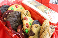 One dozen individually wrapped gourmet cookies in a festive seasonal box.  A great way to send warm wishes!