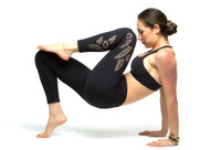 Model wearing KiraGrace Paradise Laser-cut leggings