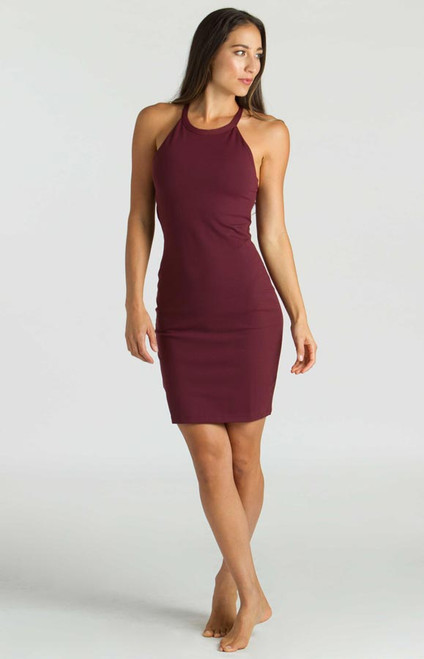 Model wearing KiraGrace Yoga Halter Dress in Bordeaux Burgundy