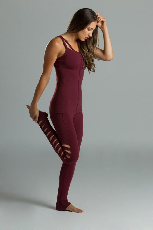 Model wearing KiraGrace supportive Caged Tank in bordeaux with Warrior Tough Cut Yoga Leggings in bordeaux