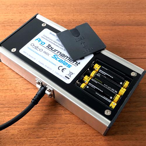 Model 357 scale showing that it runs on four triple A batteries