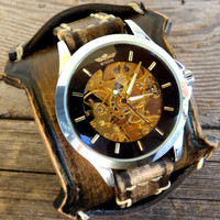 Brown and Black Skeleton Watch
