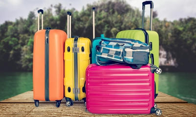 coloured suitcases piled on top of eachother