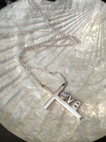 """Love Cross™ NORTH STAR in solid sterling silver on an 18"""" silver chain.   Pendant Size: 1-1/8"""" x 3/4""""  Made in USA."""