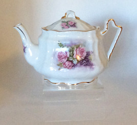 Lilacs and Roses 16 oz porcelain teapot.  White with pastel floral pattern and gold trim