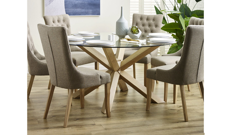 Round tempered glass dining suite with oak legs and 6 for Round table dining suites