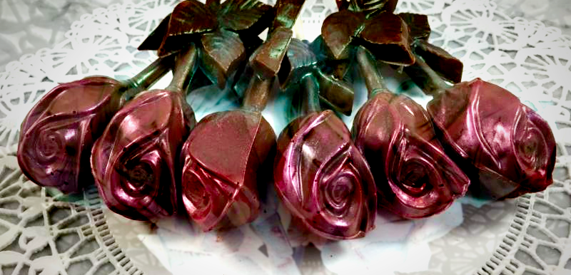 Six handcrafted, hand-painted chocolate roses are colored with an elegant misty rose colored edible sheen.