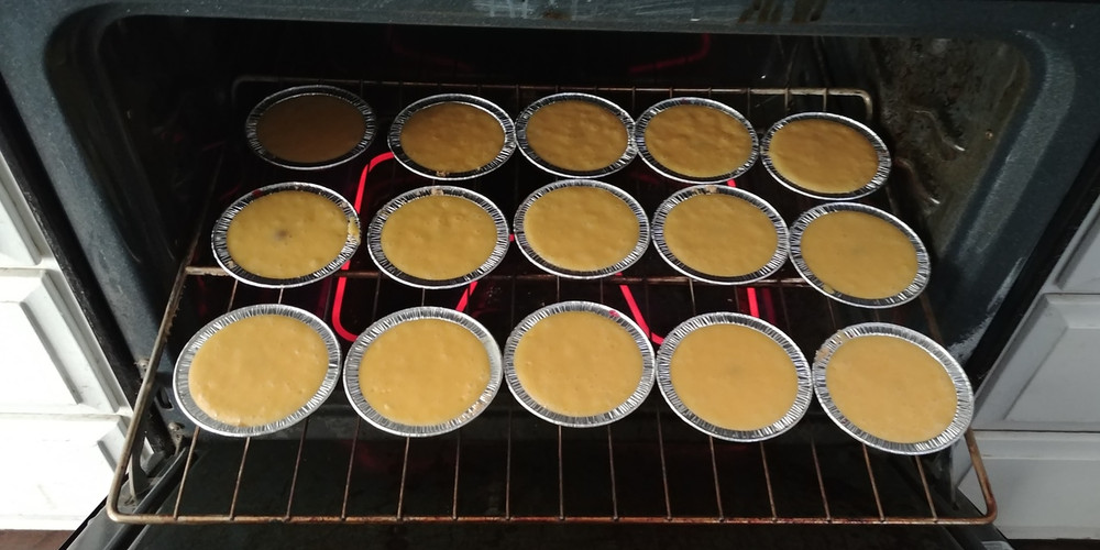 Pineapple upside down cakes - mini's - going in the oven.