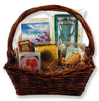 Gift basket with prairie corn, flax chips, jerky, beef sticks, candy sunflower seeds, trail mix, and glacial rocks