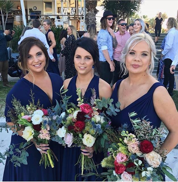 Styling perfection, Shae and Co looking striking in our Navy Convertible Bridesmaids Dresses