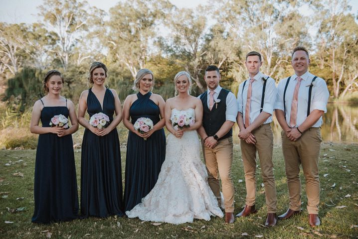Em and her stunning bridal party wearing our Navy 