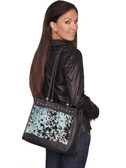 HAIR ON CALF HANDBAG.  TOP CENTER TAB WITH MAGNETIC SNAP CLOSURE.  INTERIOR ZIP AND TWO OPEN POCKETS.  EXTERIOR REAR ZIP POCKET.  SIZE: 13 INCH X 11 INCH X 4 INCH.